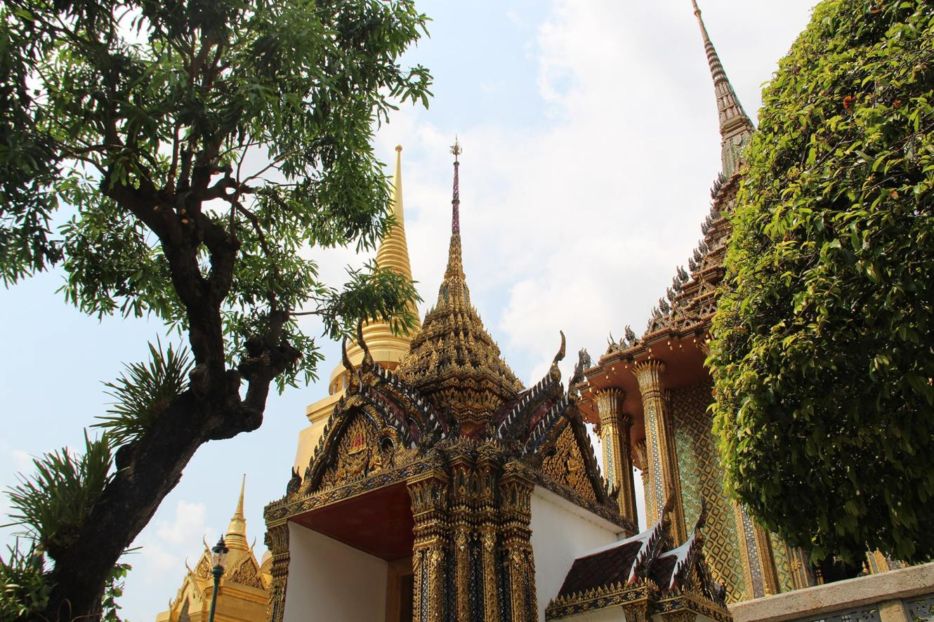 Decorations of a roof in Bangkok Grand Palace and tree
