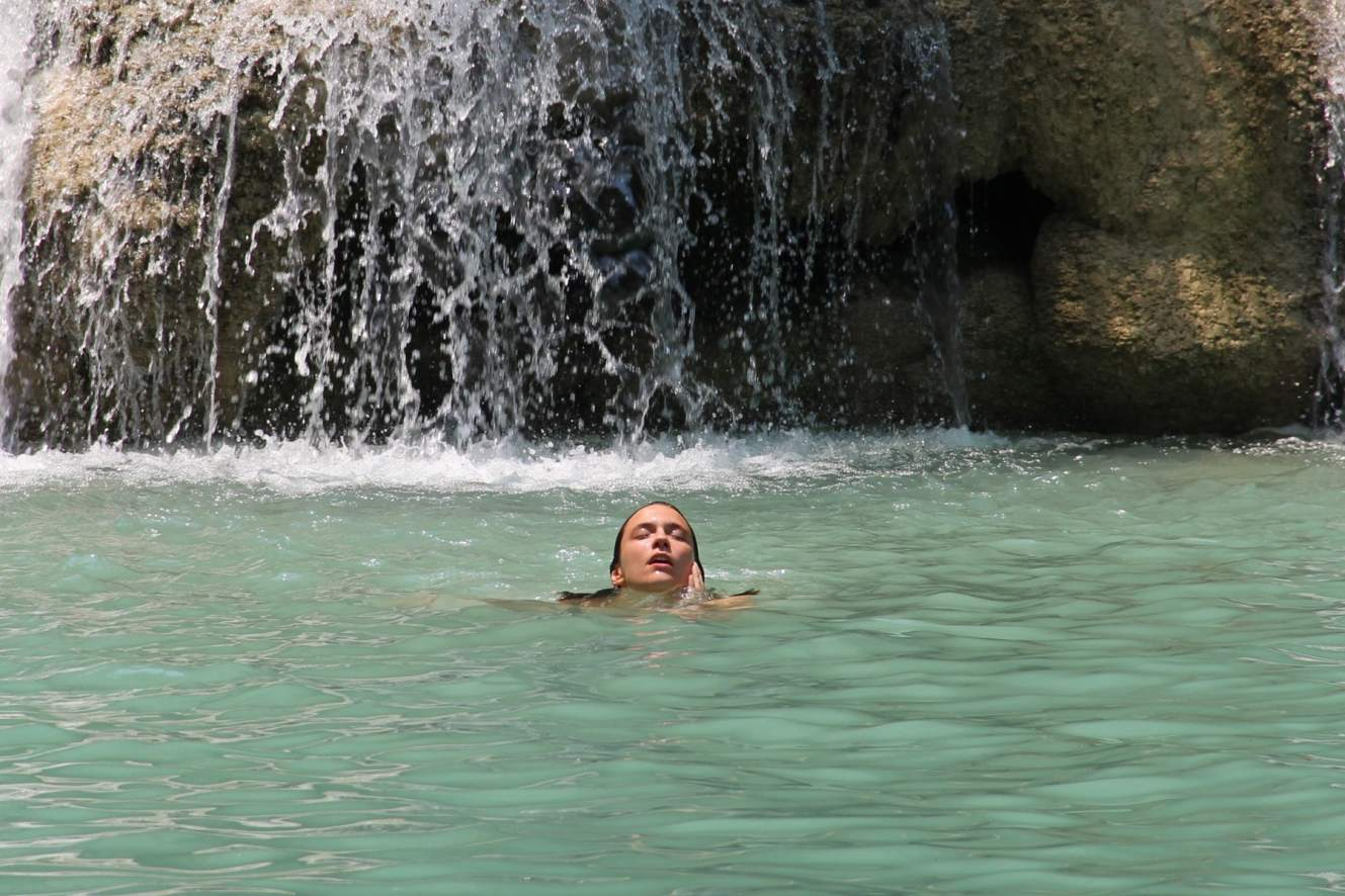 Marianna bathing in freezing waters in Kuang Si