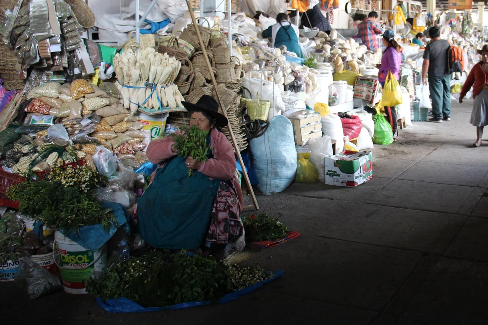 Woman selling herbs at San Pedro market Cuzco