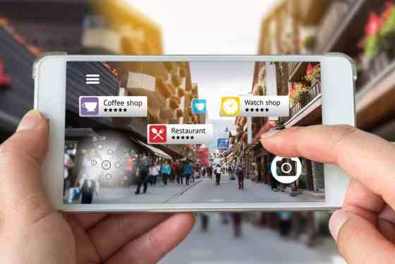 AR relevancy concept through smartphone in landscape view on busy street.