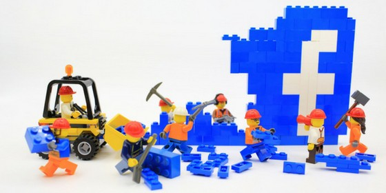 Facebook algorithm changes destroying business depicted by LEGO construction crew.