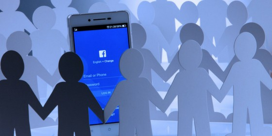 Group of paper people surrounding a Facebook Algorithm change on a mobile phone.