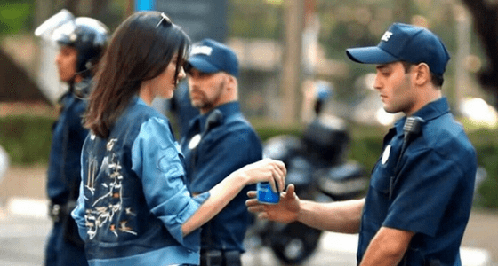 kendall jenner handing pepsi to police officer in poorly written pepsi ad