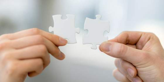software integration for small business accounting software represented by two white puzzle pieces fitting together.