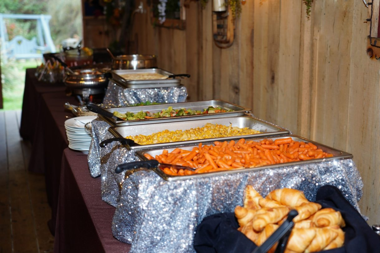 Wedding Reception Food Catering Setup with carrots and corn and bread