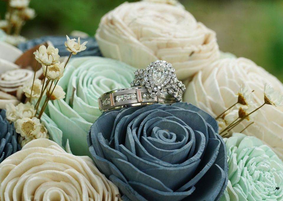 Blue and White Sola Wood flower wedding bouquet with rings sitting on top