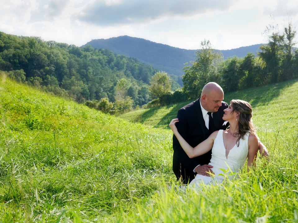 Wedding couple in a field with a mountain view in Pigeon Forge Tennessee