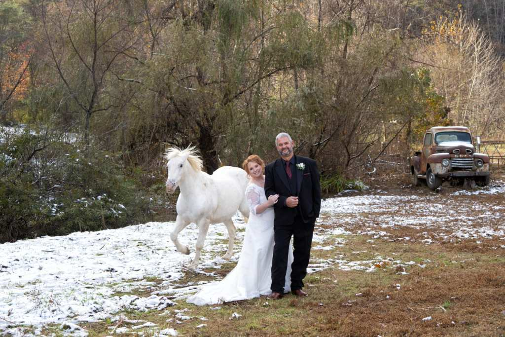 White Horse with Wedding Couple at Honeysuckle Hills
