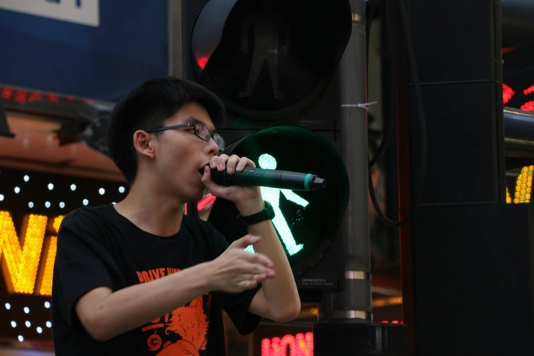 Scholarism leader Joshua Wong urged students to lobby alumni serving as legislators to veto the political reform package (photo via Scholarism).