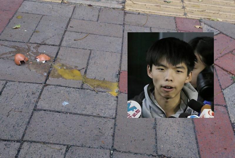 Joshua Wong was hit by eggs earlier. Photo: Inmedia HK.