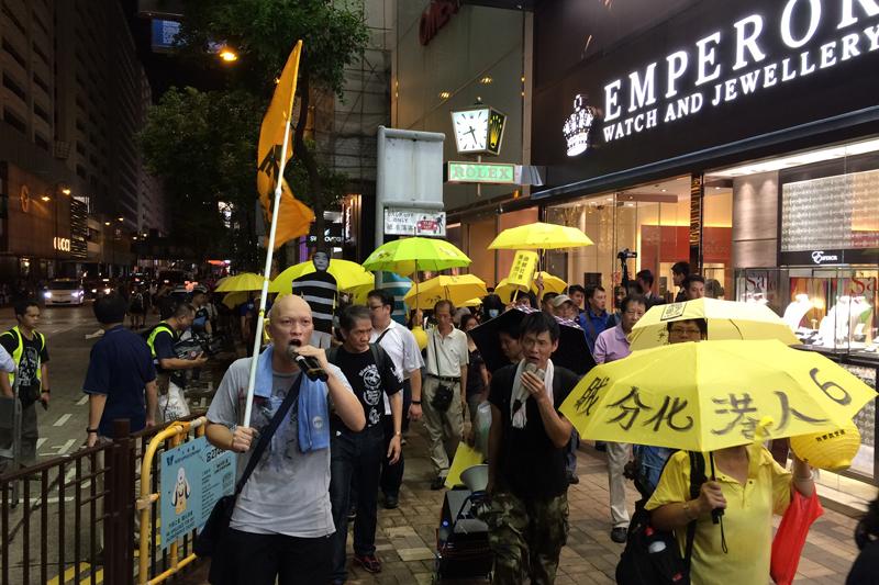 Protesters passing through Tsim Sha Tsui.