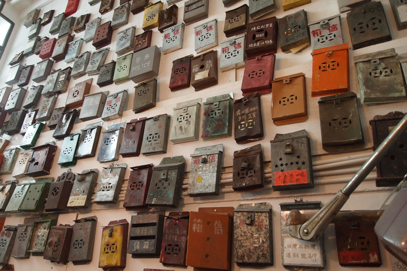 A wall of old Hong Kong postel boxes that Douglas Young collected.