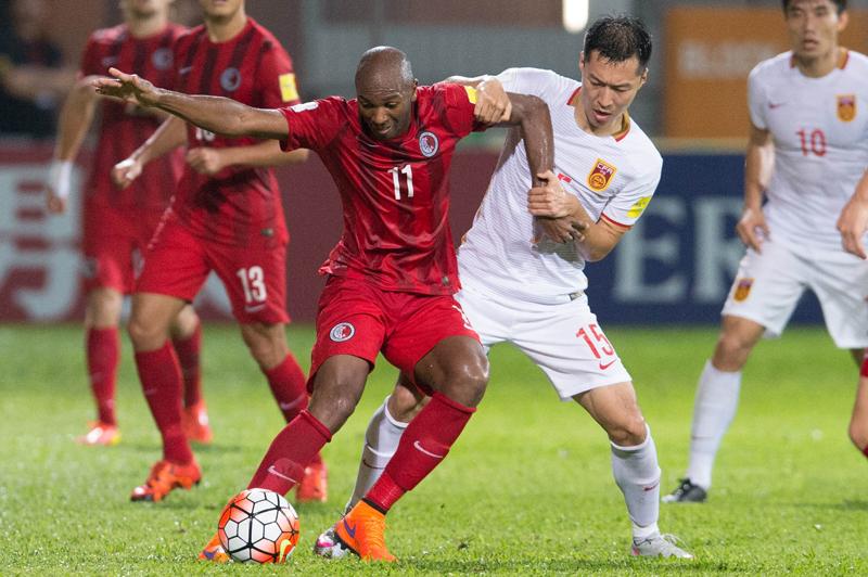 Hong Kong player Sandro against Chinese player Wu Xi. Photo: Hong Kong Football Association.