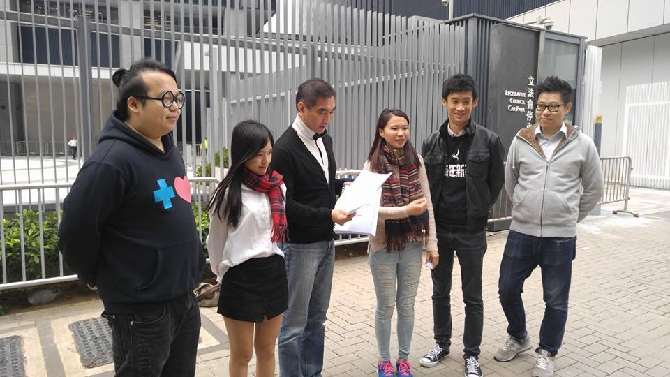 Representative of civil groups giving Felix Chung the materials and test papers.