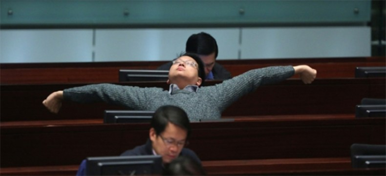 A pro-Beijing camp lawmaker being relaxed at the meeting.