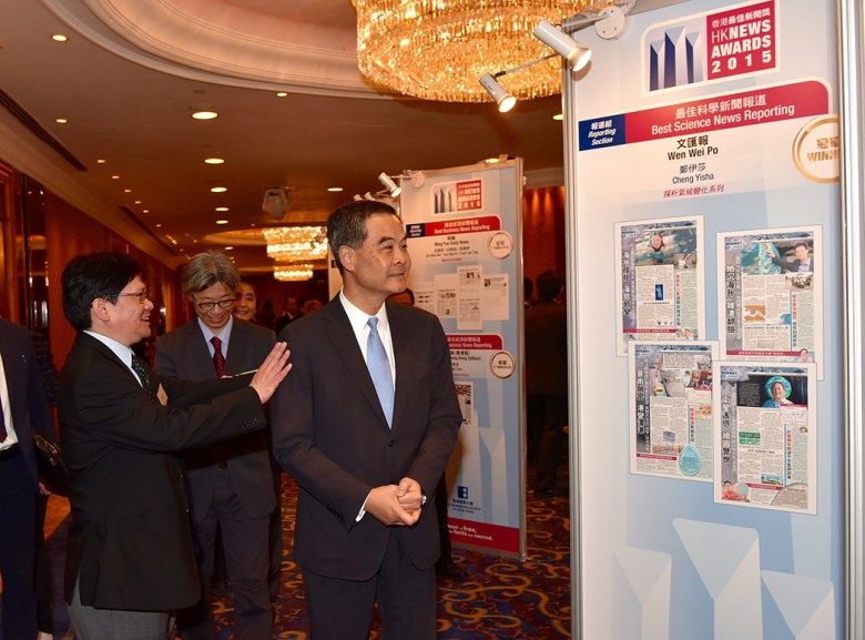 Chief Executive Leung Chun-ying visiting the winners' exhibit at the HK News Awards. Photo: GovHK.