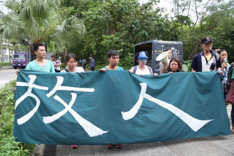 Some 20 activists have marched to the Sheung Shui police station in support of the arrested four