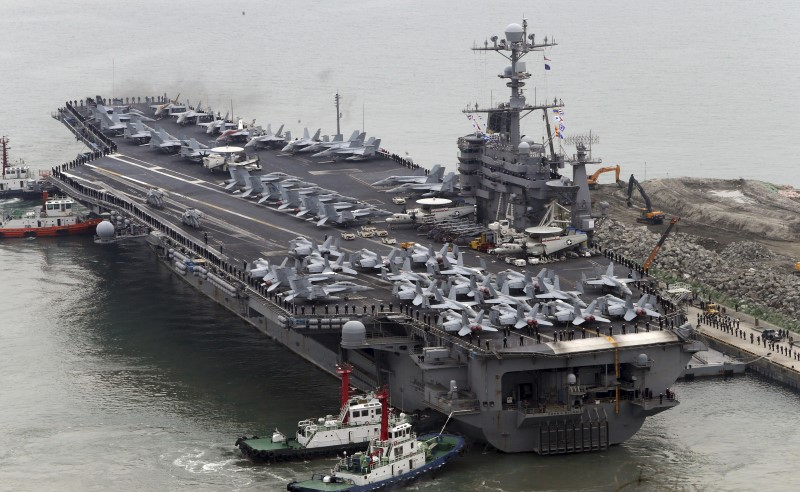 The Nimitz-class aircraft carrier USS John C. Stennis arrives to join the annual Key Resolve military exercise conducted by South Korea and the U.S., at a port in Busan, South Korea, March 13, 2016.  Photo: Reuters/Cho Jung-ho/Yonhap.