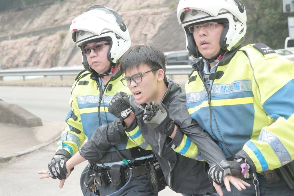 Oscar Lai held by police