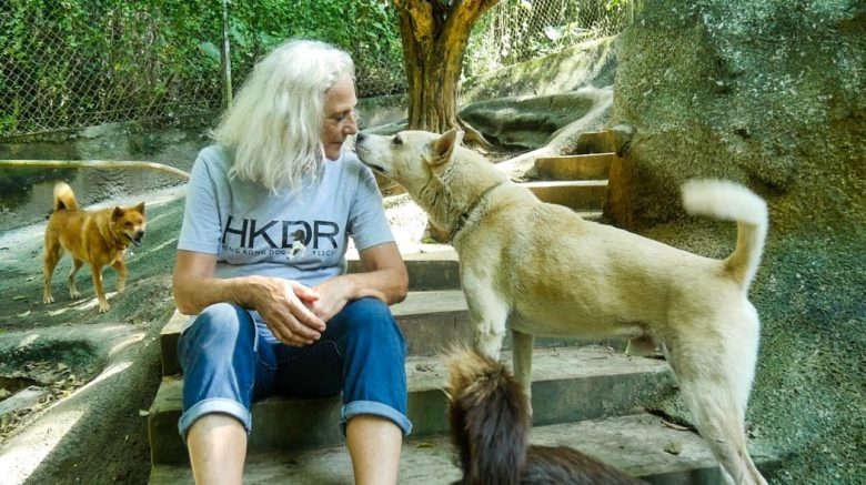 Sally Andersen interacting with a dog at HKDR's Tai Po Homing Centre