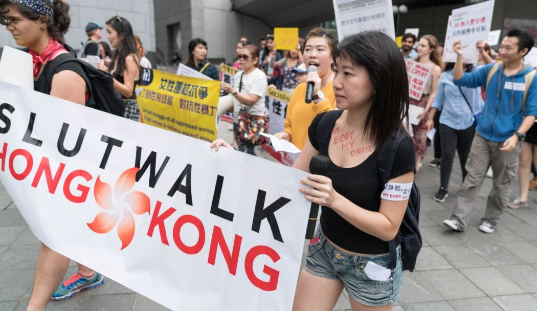 demonstrators marching slutwalk hong kong