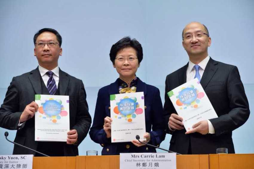 (left to right) Rimsky Yuen, Carrie Lam, and Raymond Tam. File Photo: Gov HK.