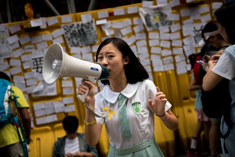 girl demonstrator democracy occupy hong kong protest umbrella