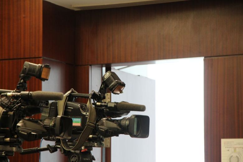 Cameras media journalists