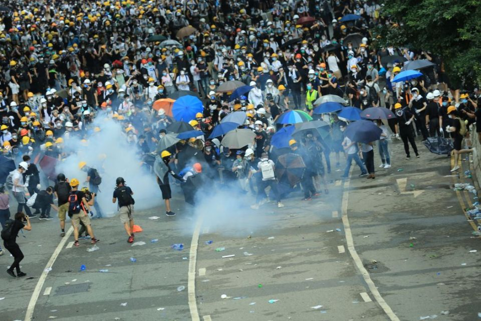 extradition protest clash smoke tear gas