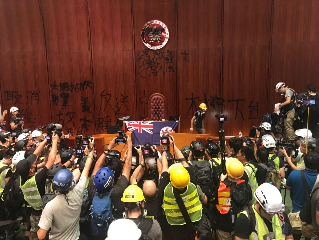 media journalists legco storming july 1 colonial flag