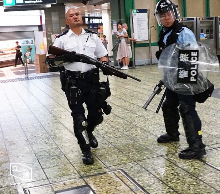 gun police remington july 30 china extradition kwai chung police station (4)