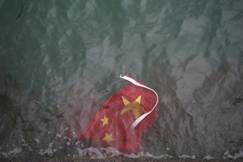 China flag sea Chinese Harbour city extradition bill government