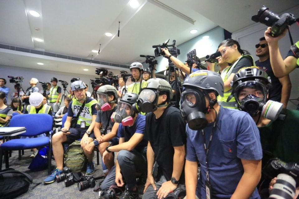 police press conference full gear journalists protest