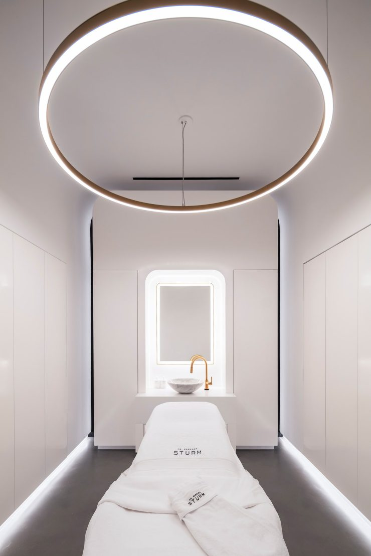 pA floating light fixture hangs over one of three treatment beds.p