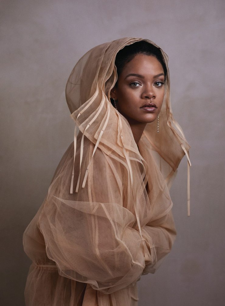 Image may contain Clothing Apparel Rihanna Human Female Person Face Sleeve and Woman