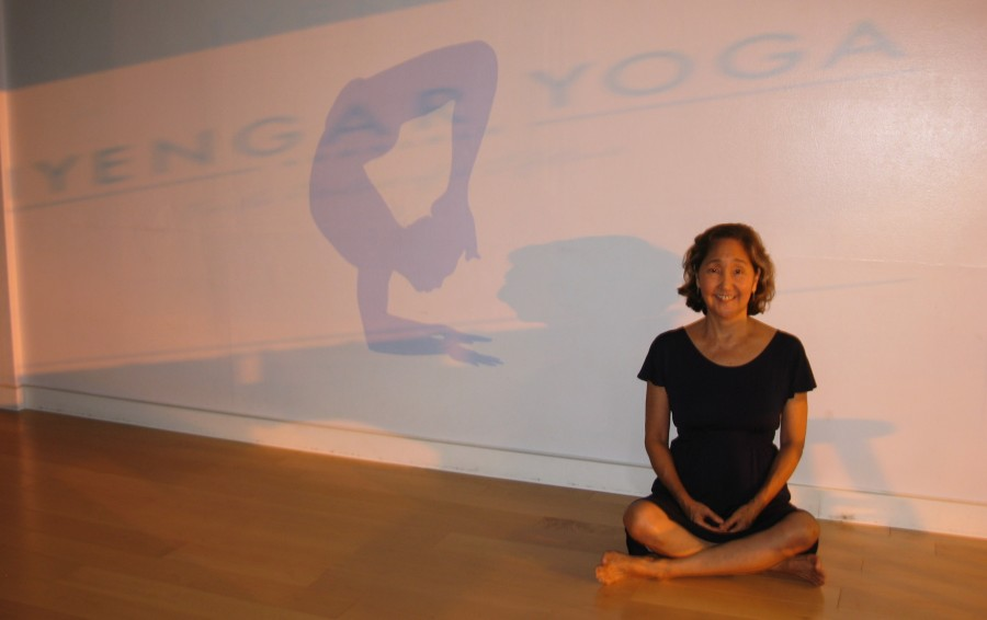 Shelley sitting in the yoga center.