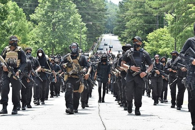 NFAC 2020 - A procession of Africans dressed all in black, open carrying guns.