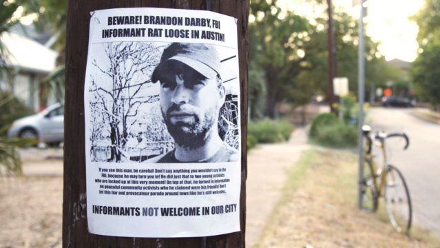 A flyer on a telephone pole warning folks in Austin, Texas about Brandon Darby, a onetime leftist activist who eventually became an FBI informant.