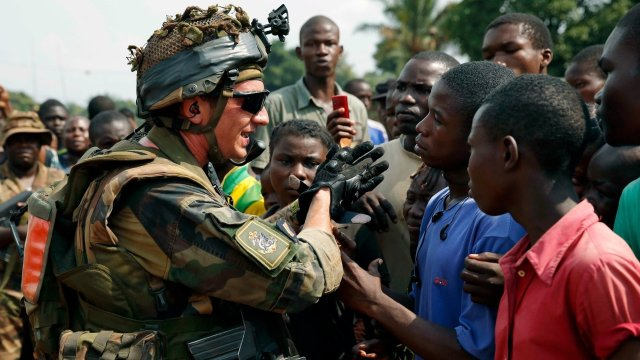 A French soldier talks to a crowd outside a church in Bangui, capital of the Central African Republic, on Thursday.