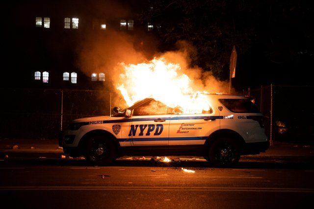 An NYPD car on fire.