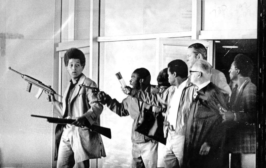 Jonathan Jackson, 17, with William Christmas, James McClain and Ruchell Magee take judge, prosecutor, three jurors as hostages to waiting van Aug. 7, 1970