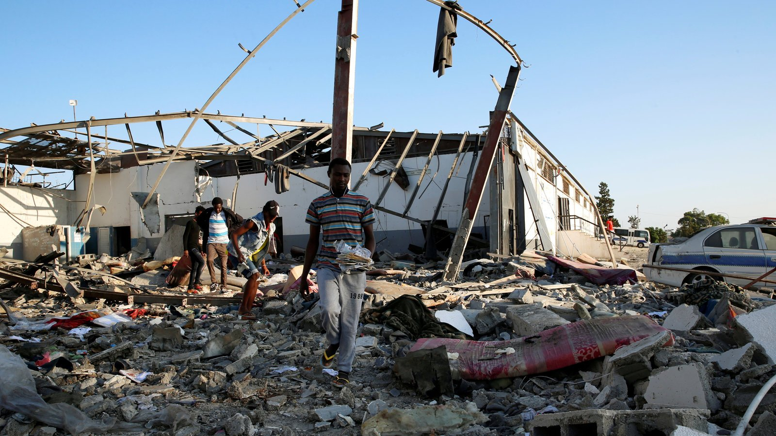 Migrants in the rubble of a detention center in Tajoura, Libya, after it was hit by an airstrike that killed dozens of people.