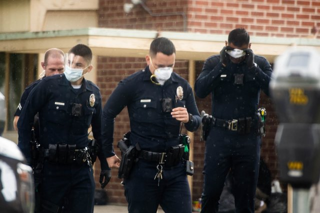 Police wearing face masks