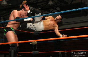 Sean Carr getting kicked by Eddie Edwards.