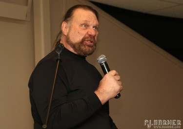 Hacksaw keeps the crowd entertained with tales from the road.