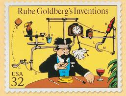 "For those unfamiliar with the ""Rube Goldberg"" reference, he was a cartoonist of the early 20th Century, made famous by is cartoons of crazy assemblages of mismatched parts to perform otherwise simple functions."