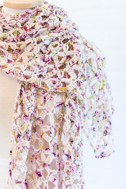 Gala Confetti, a paid crochet shawl pattern by Mary Beth Temple for SweetGeorgia Yarns.