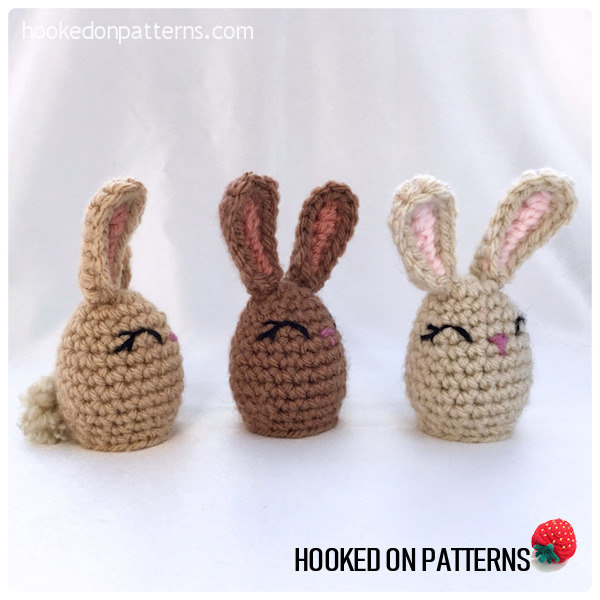 A photo of 3 completed crocheted Bunny Creme Egg covers