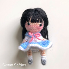 A thumbnail photo of the Suki the School Girl Doll free crochet pattern