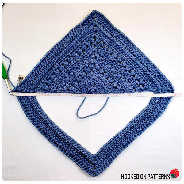 A photo showing how the Bonnie Tunic crochet pattern should look after completing the upper body section.